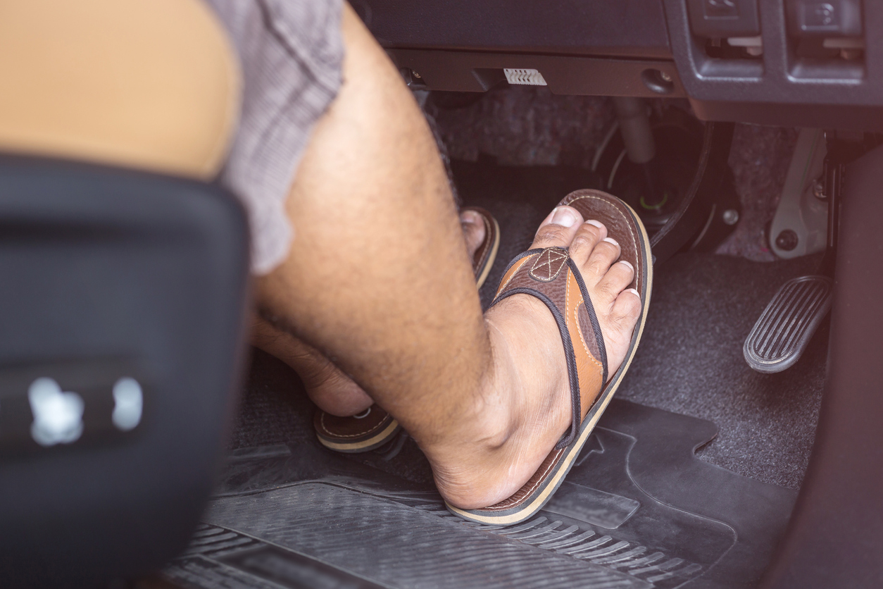 Man wearing flip flops in car